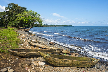 Wooden canoes on the rocky coast of the island of Bioko, Equatorial Guinea, Africa