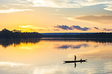 Boys washing themselves at sunset over the Sangha River flowing through the Dzanga-Sangha Special Reserve, UNESCO World Heritage Site, Central African Republic, Africa