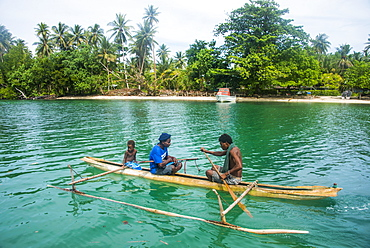 Locals in a dugout canoe, Kavieng, New Ireland, Papua New Guinea, Pacific