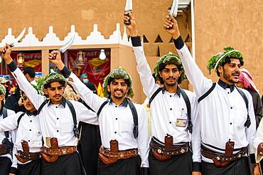Colourful traditionally dressed men, Al Janadriyah Festival, Riyadh, Saudi Arabia, Middle East