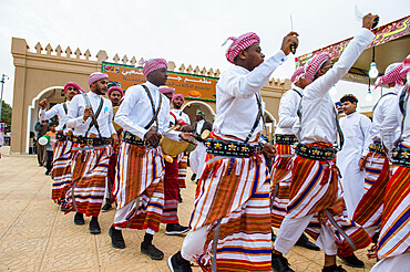 Traditional dressed local tribesmen dancing at the Al Janadriyah Festival, Riyadh, Saudi Arabia, Middle East
