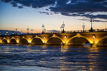 Historic bridge Pont de Pierre over the Garonne River at sunset, Bordeaux, Aquitaine, France, Europe