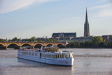 Cruise sailing in front of the skyline of Bordeaux, Aquitaine, France, Europe