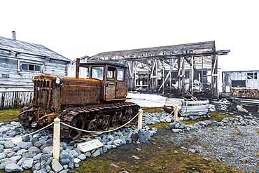 Historical caterpillar in the meteorological station Sedov in Tikhaya Bay on Hooker island, Franz Josef Land archipelago, Arkhangelsk Oblast, Arctic, Russia, Europe