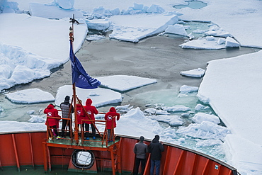 Tourists watching the ice breaking on board of an icebreaker, North Pole, Arctic