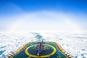 Fog bow or white rainbow in the ice around the North Pole, Arctic