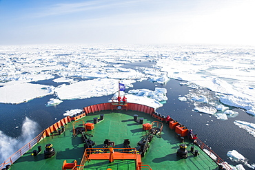 People enjoying the breaking ice on board of an icebreaker, North Pole, Arctic