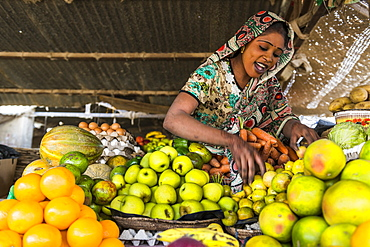 Happy sales woman on her fruit stall, Abeche, Chad, Africa