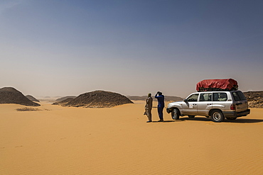 Expedition Jeep in the desert between Ounianga Kebir and Faya, northern Chad, Africa