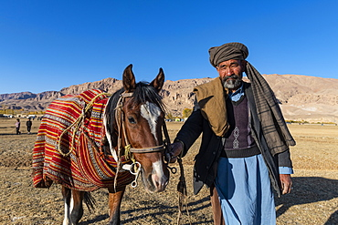 Old man with his horse at a Buzkashi game, Yaklawang, Afghanistan, Asia