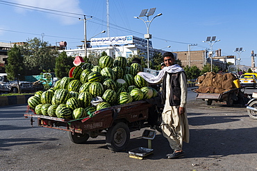 Man selling water melons, Herat, Afghanistan, Asia