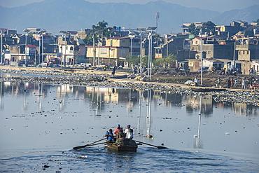 Totally polluted River Mapou flowing through Cap Haitien, Haiti, Caribbean, Central America