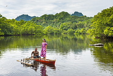 Couple in dugout canoe, Kosrae, Federated States of Micronesia, South Pacific