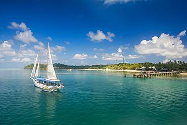Sailing boat anchoring on Mana Island, Mamanuca Islands, Fiji, South Pacific