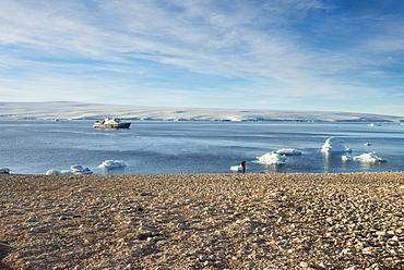 Icebreaker anchoring behind an iceberg, Paulet Island, Antarctica, Polar Regions