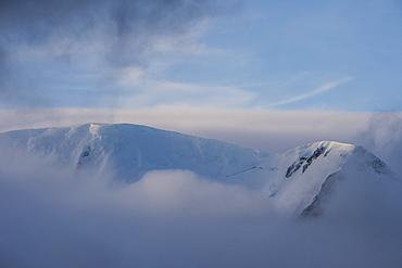 Mountain breaking through the clouds, Elephant Island, South Shetland Islands, Antarctica, Polar Regions