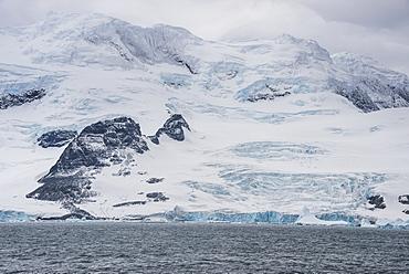 Glacier hanging on the rocks of Coronation Island, South Orkney Islands, Antarctica, Polar Regions