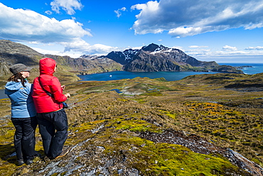 Tourists admiring the stunning scenery of Godthul, South Georgia, Antarctica, Polar Regions