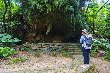 Woman with a baby hiking in the Sacred site of Sefa Utaki, UNESCO World Heritage Site, Okinawa, Japan, Asia