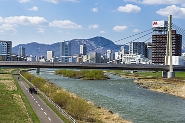 Massive bridge spanning the Ishikari River flowing through Sapporo, Hokkaido, Japan, Asia