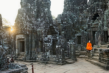 Monk sitting sitting in the Bayon temple, UNESCO World Heritage Site, Angkor, Siem Reap, Cambodia, Indochina, Southeast Asia, Asia