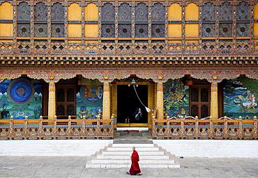 Monk walking through Punakha Dzong, Punakha District, Bhutan, Asia