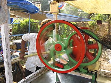 India. Sugar cane juice vendor in mumbai