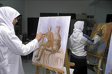 Art class, palestine. Gaza. Young women painting at an art class