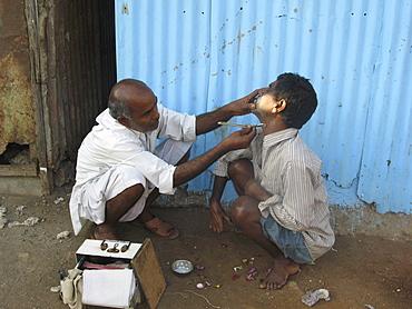 India. Barber in streets of colaba, mumbai