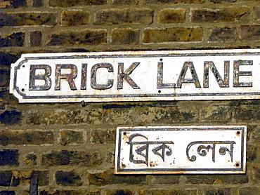 Uk- bilingual road sign in english and bengali in brick lane, east london