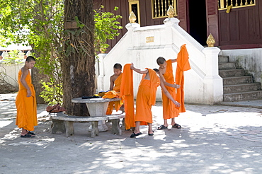 Laos, monks at a monastery in the holy city of luang prabang