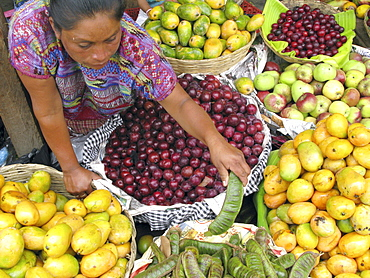 Guatemala native quiche woman selling fruit in a market place in guatemala city