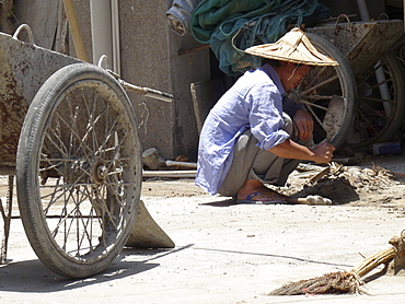 China migrant worker as self-employed cleaner in xiamen in fujian province