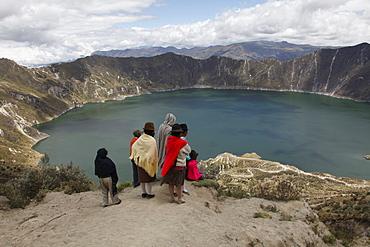 Native people and tourists visit the Laguna de Quilotoa crater lake near Latacunga, Ecuador, South America