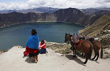 Native people visit the Laguna de Quilotoa crater lake near Latacunga, Ecuador, South America