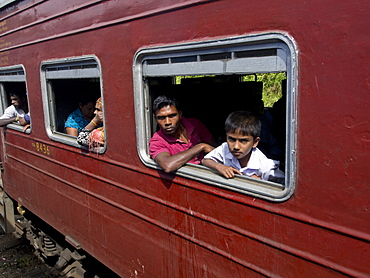 Passengers in the train journey from Kandy to Ella, in the highlands of Sri Lanka, Asia