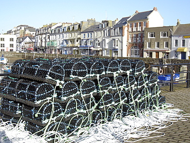 Uk fish cages in the harbour at ilfracombe, devon