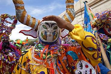 Revellers in costumes and masks at Humahuaca carnival in Jujuy province in the Andes region of Argentina, South America