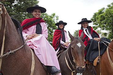 Women in a parade of gauchos in traditional costumes in Salta, Argentina,South America