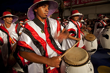 Traditional Murgas and samba schools during the Llamadas procession that starts the carnival in Montevideo, Uruguay, South America
