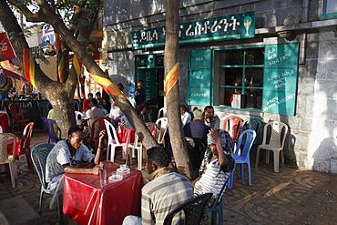 People talking and sitting in cafes in Bahir Dar, Ethiopia, Africa