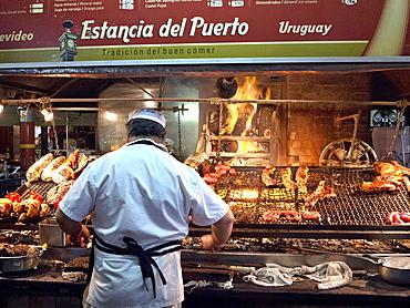 Parilla barbeque restaurant in the Mercado del Puerto, Montevideo, Uruguay, South America