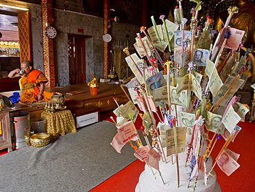 Monk and money gifts in the Wat Phra That Doi Suthep Buddhist temple in Chiang Mai, Thailand, Southeast Asia, Asia