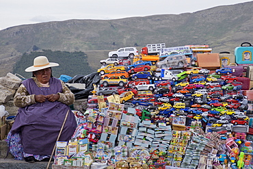 Traditional miniature cars and money thought to give good luck for sale at a stall in the resort of Copacabana on Lake Titicaca, Bolivia, South America