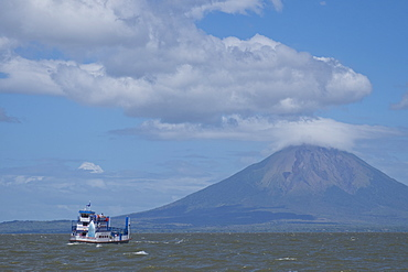 Passenger ferry and volcano with Ometepe Island in background, Nicaragua, Central America