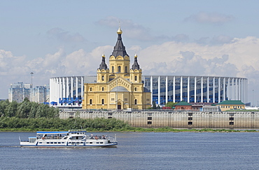 View of the Alexander Nevsky Cathedral and 2018 World Cup football stadium in Nizhny Novgorod across the Volga River, Russia, Europe