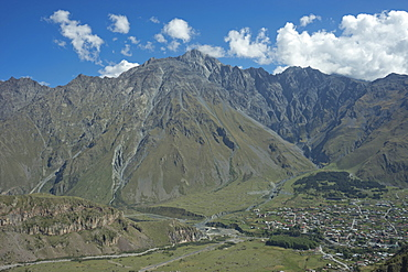 View of the mountains near the Gergeti Holy Trinity Church by the river Chkheri, under Mount Kazbegi at an elevation of 2170 meters in the Caucasus, Georgia, Central Asia, Asia