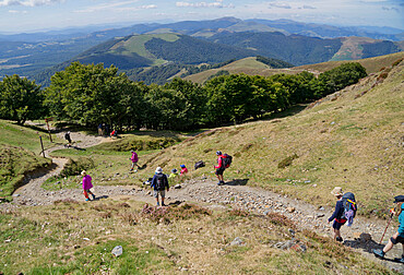 Christian pilgrims walking at Camino de Santiago (St. James' Way) route in Spain, Europe