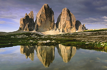 Dolomites, italy. South tyrol. Area of the three chimneys,from left to right: small chimney 2857 m; big chimney 2999 m; western chimney 2973 m; reflecting in a small puddle of water
