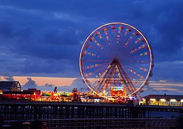Big wheel and funfair on Central Pier lit at dusk, Blackpool Illuminations, Blackpool, Lancashire, England, United Kingdom, Europe